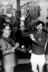 Rangers captain John Greig lifts the European Cup Winners Cup after receiving it from UEFA President Gustav Wiederkehr